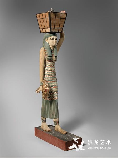 《搬运贡品的女性像》(Statue of an Offering Bearer),古埃及第12王朝,约前1981—前1975年,木质彩绘,高112厘米,纽约大都会博物馆